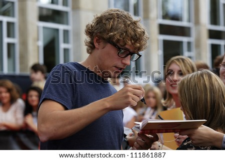 LUDWIGSBURG - AUGUST 29: Musician Tim Bendzko , many national and international superstars from the music scene in the Forum Theatre celebrated in Ludwigsburg, Germany.  August 29, 2012. - stock photo