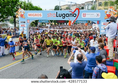 Lugano, Switzerland - 22 may 2016: Marathon runners packed tightly together right out of the starting line of StraLugano half marathon. - stock photo