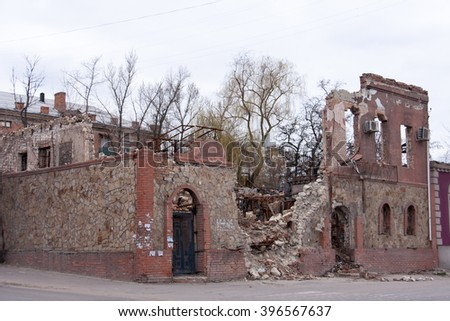 LUGANSK ,UKRAINE - MARCH 25, 2016:  The destroyed building after a mortar attack - stock photo