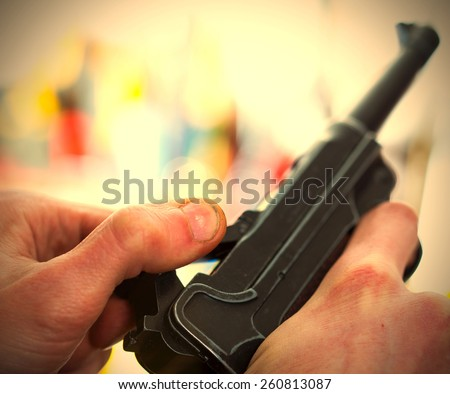 Luger automatic pistol in a human hands, shallow depth of field. close-up. instagram image retro style - stock photo