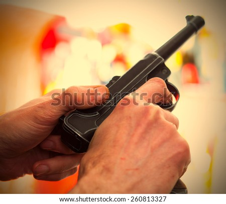 Luger Parabellum automatic pistol in a hands, shallow depth of field. close-up. instagram image retro style - stock photo