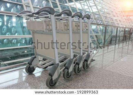 Luggage cart at modern airport. - stock photo