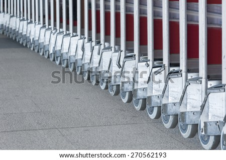 luggage carts at modern airport - stock photo