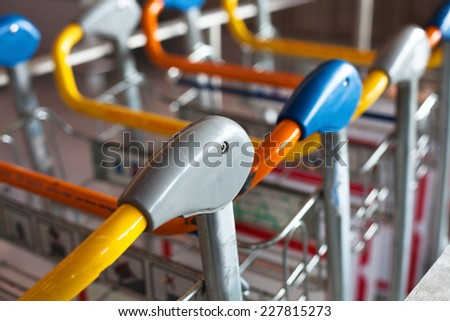 luggage carts in the airport, close up - stock photo