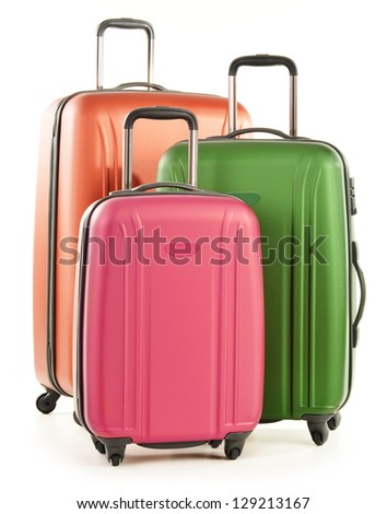 Luggage consisting of large polycarbonate suitcases isolated on white - stock photo