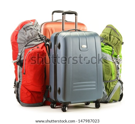 Luggage consisting of large suitcases and rucksacks isolated on white - stock photo