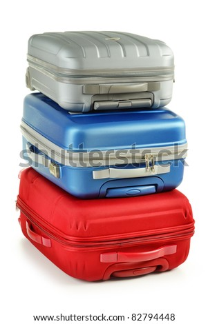 Luggage consisting of polycarbonate suitcases isolated on white. Red blue and grey travel bags - stock photo