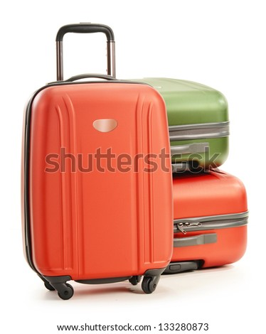Luggage consisting of three polycarbonate suitcases isolated on white - stock photo