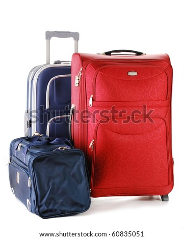 Luggage consisting of two large suitcases and travel bag isolated on white - stock photo