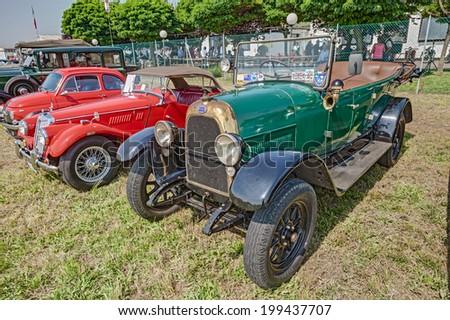 "LUGO, RA, ITALY - JUNE 7: old italian car Fiat 501 (1924) exposed at festival ""Belle Epoque"" of Aero Club Lugo on June 7, 2014 in Lugo, RA, Italy    - stock photo"