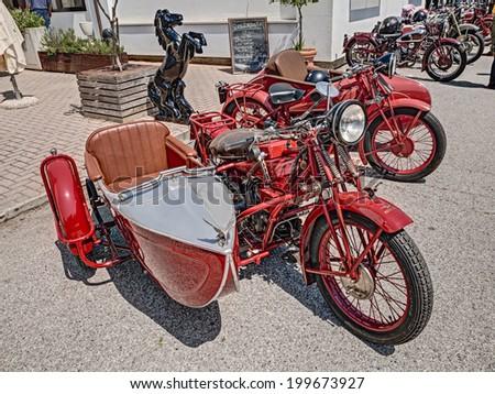 "LUGO, RA, ITALY - JUNE 7: vintage italian motorcycle Moto Guzzi with sidecar exposed at festival ""Belle Epoque"" of Aero Club Lugo on June 7, 2014 in Lugo, RA, Italy    - stock photo"