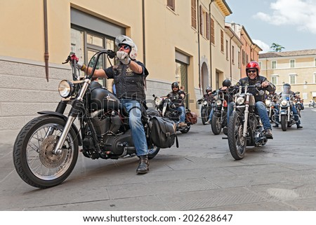 """LUGO, RA, ITALY - SEPTEMBER 22: a group of bikers riding american motorbikes Harley Davidson at motorcycle rally """"Sangiovese tour"""" by Ravenna Chapter on September 22, 2013 in Lugo (RA) Italy - stock photo"""