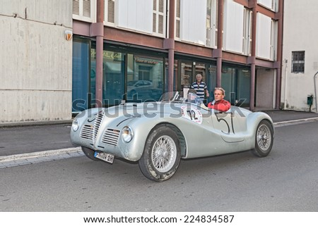 "LUGO, RA, ITALY - SEPTEMBER 21: the crew Sthele - Mosel on a vintage racing car Alfa Romeo 6C 2500 SS (1947) in classic cars race ""Gran Premio Nuvolari"" on September 21, 2014 in Lugo, RA, Italy  - stock photo"