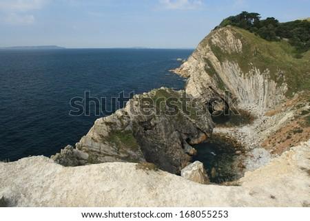 Lulworth Cove in Dorset, UK - stock photo