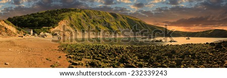 lulworth cove in the morning, coastal panorama england - stock photo