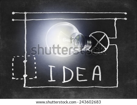 Luminous lamp with drawn in chalk on the Blackboard electrical circuit - stock photo