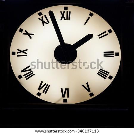 Luminous wall clock, closeup shot - stock photo