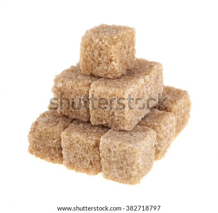 Lump brown cane sugar cubes isolated on white background - stock photo