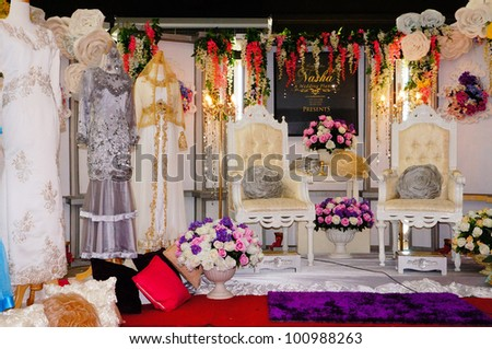 LUMUT, MALAYSIA - APR 22: Wedding photographer booth from Amanda Studio promote their services to visitors during Perak Bridal Carnival at Marina Island Hall on Apr 22, 2012 in Lumut Perak, Malaysia. - stock photo