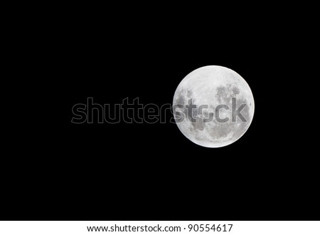Lunar eclipse as seen from Samui,Thailand December 10,2011 - stock photo
