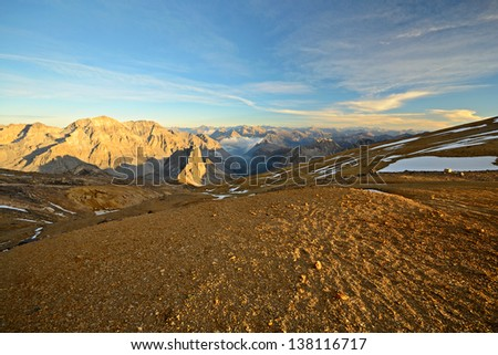 Lunar high mountain landscape at sunset from the summit of M. Thabor (3178 m) in the french Alps near the border to Italy. - stock photo