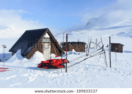 Lunch and emergency shelter on the famous Kungsleden trail in Sweden. - stock photo