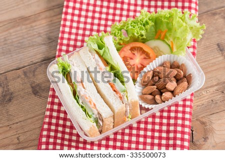 Lunch box, Tuna sandwiches with almond. Top view. - stock photo