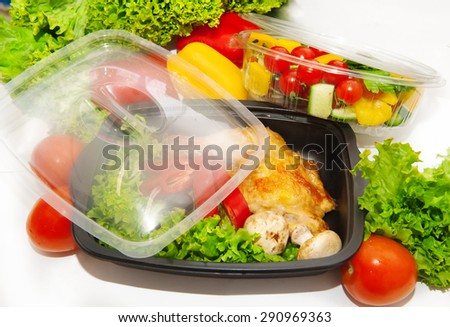Lunch box with grilled chicken and vegetables - stock photo