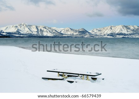 Lunch dining table with beautiful mountain cover in snow at winter - stock photo
