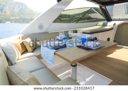 lunch on motor yacht, Table setting at a luxury yacht. - stock photo