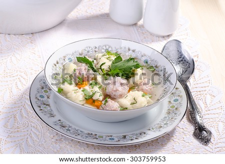 lunch, soup with meatballs and dumplings - stock photo
