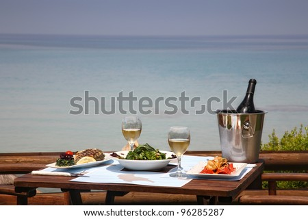 lunch table for two by the sea - stock photo