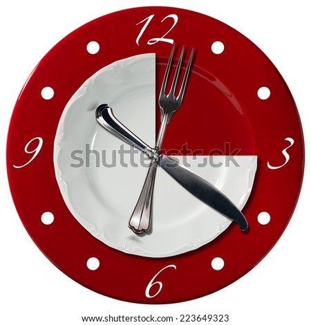 Lunch Time Concept / Clock composed by a white plate and a red underplate with fork and knife in the place of the clock hands. Lunch time concept - stock photo
