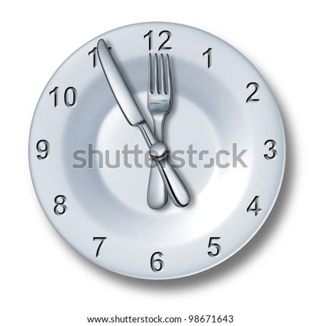Lunch time dining concept with a fork and knife on a plate in the shape of a clock with numbers as eating time or fast food entertainment in the food and drink catering business on white. - stock photo