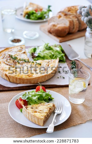 Lunch time meal with quiche and side salad, simple snack food - stock photo
