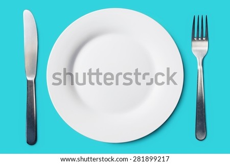 Lunch time. White plate and cutlery served for meal. Top view. - stock photo