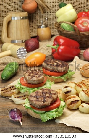 Lunch With Homemade BBQ Grilled Hamburgers And Vegetables  On The Kitchen Rustic  Wooden Table Top - stock photo