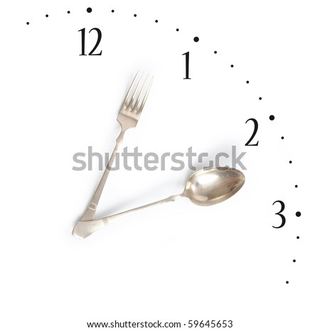 Lunchtime, clock made of fork and spoon - stock photo