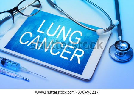 Lung cancer word on tablet screen with medical equipment on background - stock photo