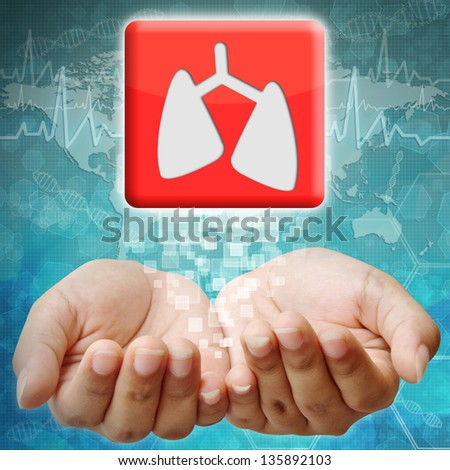 Lung icon on hand ,medical background - stock photo