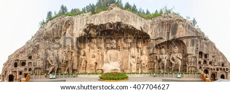 LUOYANG, HENAN/CHINA-APR 12: Longmen Grottoes -Fengxiang temple stone Buddhas on Apr 12, 2016 in Luoyang, Henan, China. The Grottoes is one of One of China's four Buddhist Caves Art Treasure Houses.  - stock photo