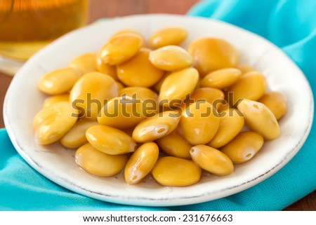 lupin beans with bear  - stock photo