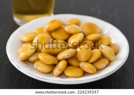 lupin beans with glass of bear - stock photo