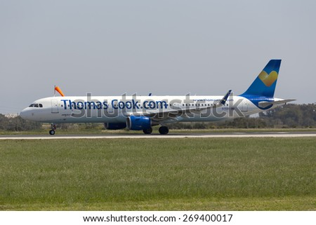 Luqa, Malta - April 14, 2015: Thomas Cook Airlines Airbus A321-211 starting its take off run, destination Manchester. - stock photo