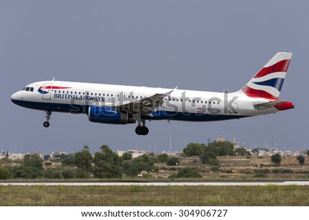 Luqa, Malta August 10, 2015: British Airways Airbus A320-232 (G-MEDK) landing runway 31. - stock photo