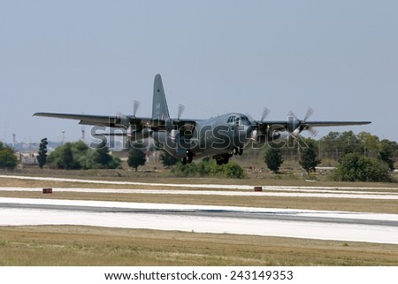 Luqa, Malta July 19, 2007: Canadian Air Force Lockheed CC-130H Hercules (C-130H/L-382) lifts off from runway 14. - stock photo