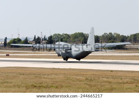 Luqa, Malta July 22, 2007: Royal Air Force Lockheed Martin C-130J Hercules C5 (L-382)  takes off from runway 31. - stock photo