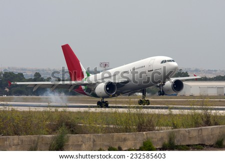 Luqa, Malta July 5, 2011: Untitled (Hi Fly) Airbus A310-304 touching down runway 13.  - stock photo