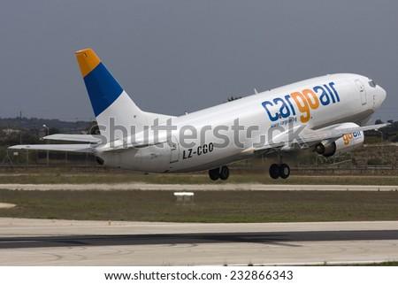 Luqa, Malta September 24, 2008: Cargo Air Boeing 737-301(SF) taking off runway 13 - stock photo