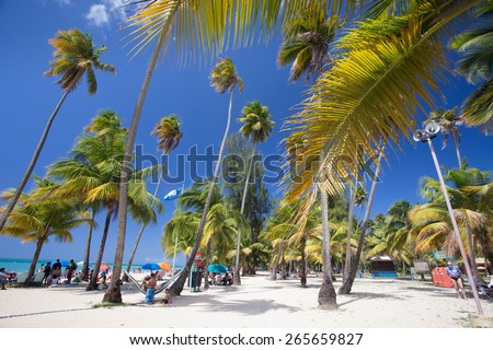 LUQUILLO BEACH, PUERTO RICO - MARCH 28, 2015:  View of beautiful tropical Caribbean beach at Luquillo Puerto Rico. - stock photo
